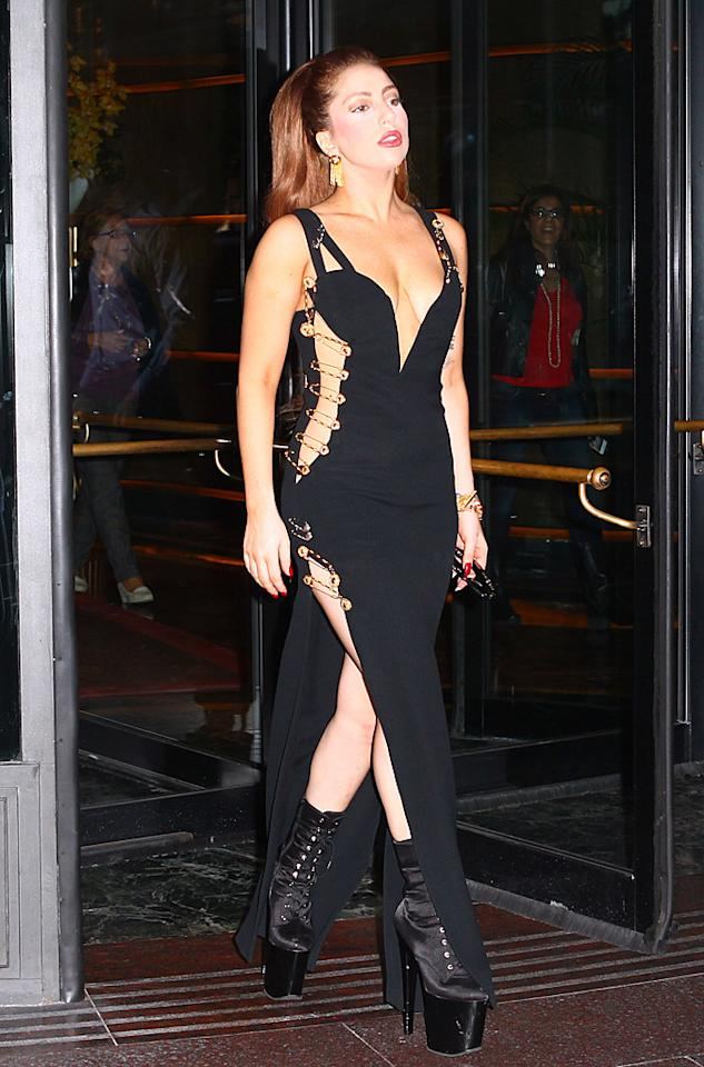 "Speaking of Versace, Lady Gaga stepped out on Tuesday in Milan, Italy, wearing the same iconic safety pin dress made famous by Elizabeth Hurley in 1994. <a target=""_blank"" href=""http://omg.yahoo.com/blogs/now/lady-gaga-steals-elizabeth-hurley-iconic-dress-180527761.html"">When Liz donned the frock at the ""Four Weddings and a Funeral"" premiere</a>, she looked stunning. Gaga, on the other hand, looked silly. Shocker. (10/2/2012)<br><br><a target=""_blank"" href=""http://omg.yahoo.com/news/gaga-admits-ive-gained-25-pounds-011000810.html"">Lady Gaga on her weight gain</a>"