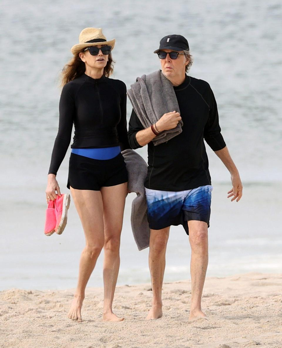 <p>Paul McCartney and wife Nancy Shevell color coordinate on July 29 while strolling along the beach in The Hamptons, New York.</p>