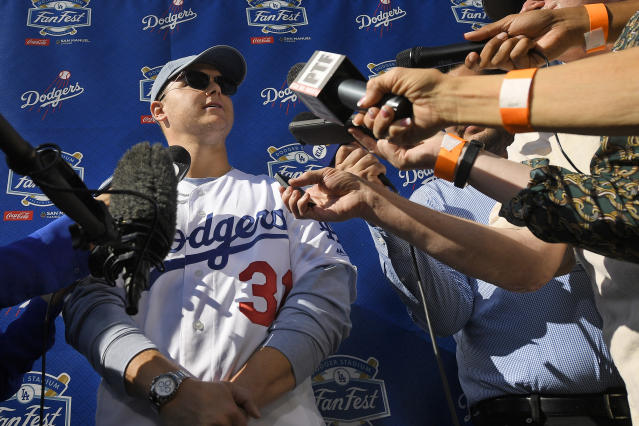 Los Angeles Dodgers' Joc Pederson is interviewed by reporters during Dodger Stadium FanFest Saturday, Jan. 25, 2020, in Los Angeles. (AP Photo/Mark J. Terrill)