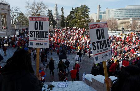 Teachers, students and members of the community hold a rally as Denver public school teachers strike for a second day