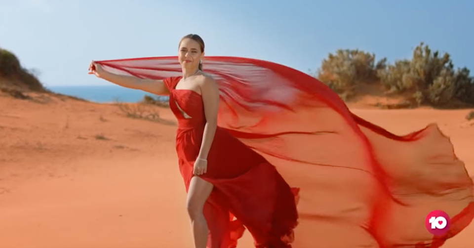 Brooke Blurton with her red dress in The Bachelorette trailer.