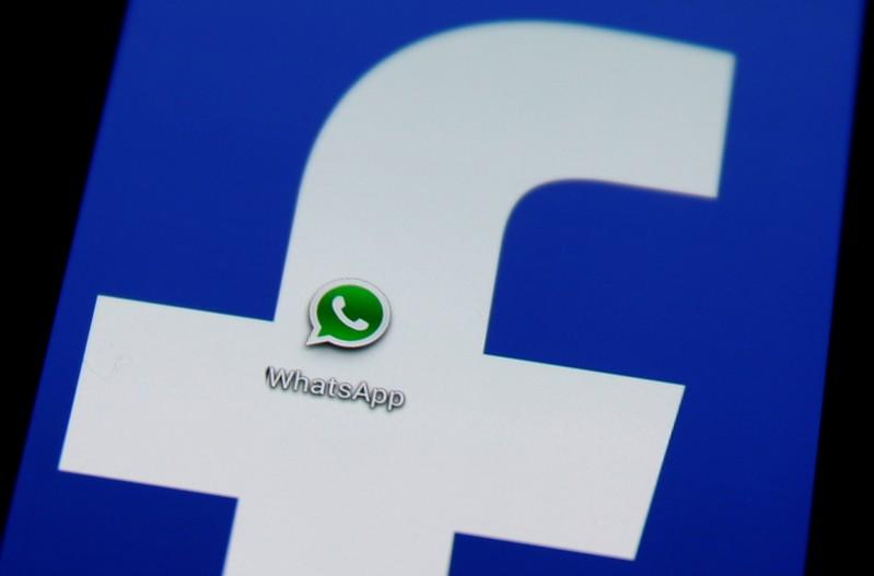 FILE PHOTO: A Whatsapp icon is seen on a Samsung Galaxy S4 phone screen with a Facebook logo in the central Bosnian town of Zenica