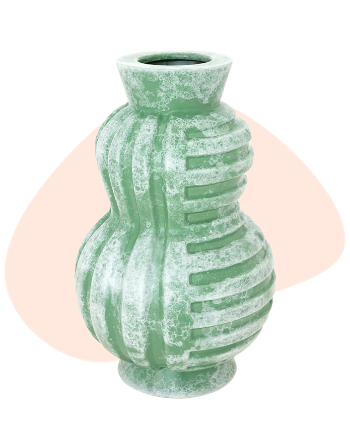 """This Jonathan Adler vase will add a pop of color to any decor. Mixing a bit of art deco and futurism, it's the perfect conversation piece. We recommend gifting with a bouquet of flowers. $245, Jonathan Adler. <a href=""""https://jonathanadler.com/products/poirot-cinch-vase?variant_id=32252786999330"""" rel=""""nofollow noopener"""" target=""""_blank"""" data-ylk=""""slk:Get it now!"""" class=""""link rapid-noclick-resp"""">Get it now!</a>"""