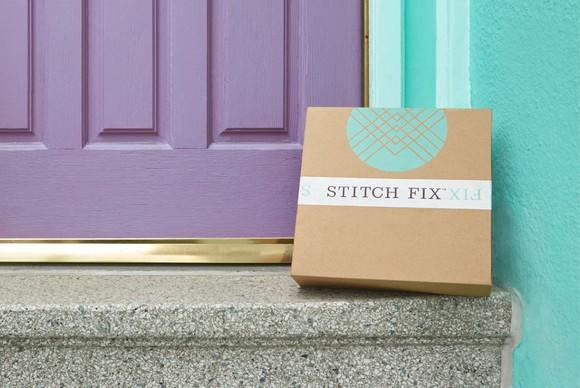 Purple door and teal wall next to faux-granite steps with Stitch Fix box resting on top step.