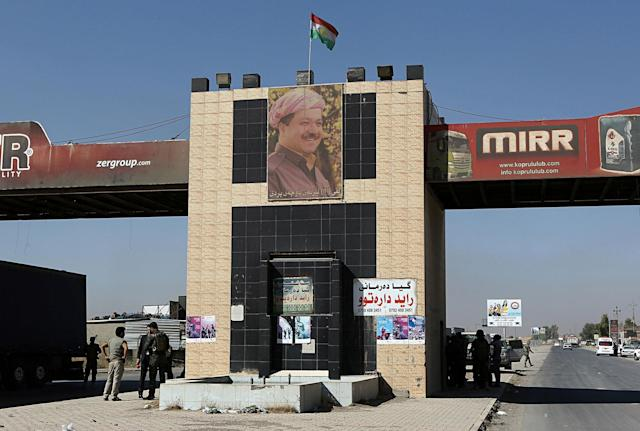 <p>A picture of Massoud Barzani, the President of Iraq's autonomous Kurdish region, hangs at a checkpoint manned by Kurdish security forces on the outskirts of Irbil, Iraq, Tuesday, Oct. 17, 2017. Kurdish forces lost more territory in Iraq on Tuesday, withdrawing from the town of Sinjar a day after Iraqi forces pushed them out of the disputed city of Kirkuk. (Photo: Khalid Mohammed/AP) </p>