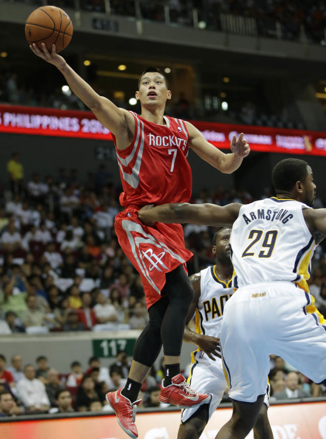 Houston Rockets' Jeremy Lin (7) eludes to score against Indiana Pacers' Hilton Armstrong during their NBA pre-season game dubbed NBA Global Games Thursday Oct. 10, 2013, at the Mall of Asia Arena at suburban Pasay city, south of Manila, Philippines. The Rockets won 116-96, in the first NBA game in this basketball-crazy Southeast Asian nation which is part of the NBA's global schedule that will have eight teams play in six countries this month.(AP Photo/Bullit Marquez)