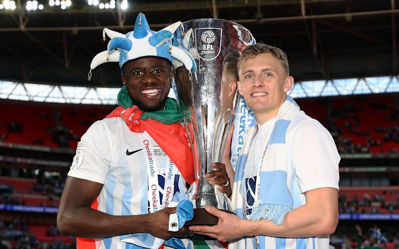 Coventry's goascoers Gael Bigirimana and George Thomas celebrate with the EFL Checkatrade Trophy - Getty Images Europe