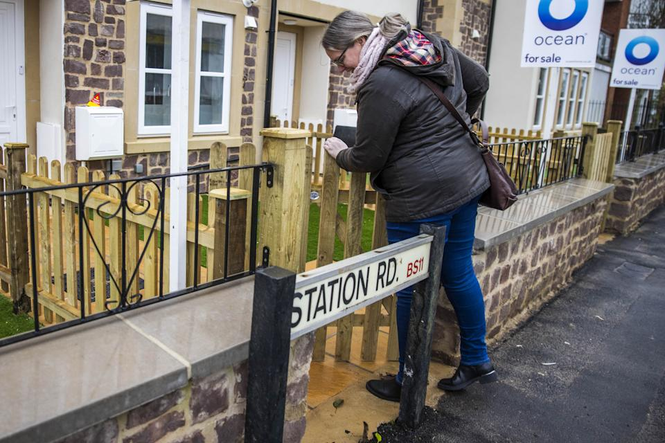 The entrance to one of the homes in Shirehampton, Bristol, has been built behind the existing Station Road street sign, which is now completely blocking the gate (swns)