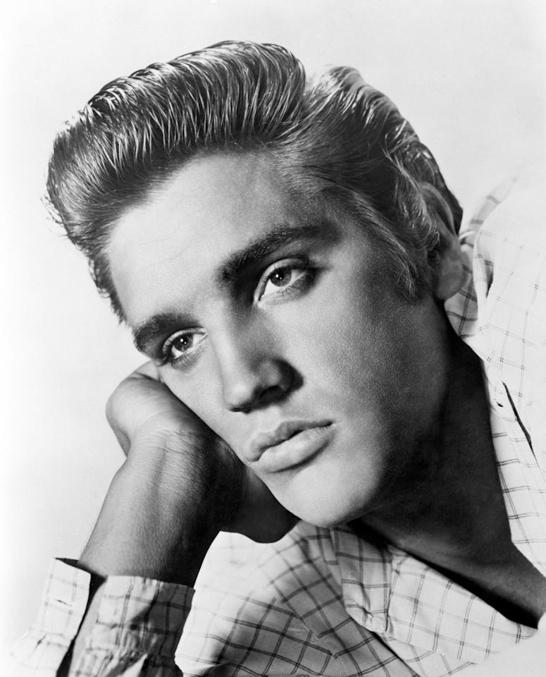 <p>While Presley's hairstyles changed fairly dramatically throughout his life, he stayed good friends with his comb and wax (apparently he used three different varieties to tame his mane.) [Photo: PA] </p>