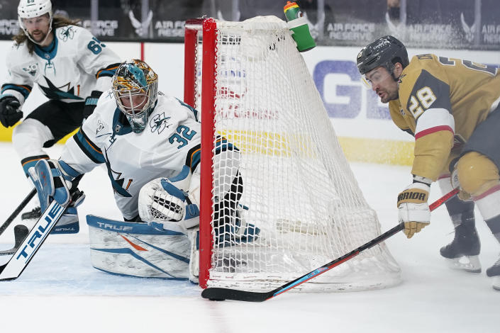 Vegas Golden Knights left wing William Carrier (28) attempts a shot on San Jose Sharks goaltender Josef Korenar (32) during the second period of an NHL hockey game Wednesday, April 21, 2021, in Las Vegas. (AP Photo/John Locher)