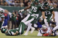 New England Patriots middle linebacker Kyle Van Noy (53) recovers the ball fumbled by New York Jets quarterback Sam Darnold, left, after Darnold was sacked during the first half of an NFL football game Monday, Oct. 21, 2019, in East Rutherford, N.J. (AP Photo/Adam Hunger)