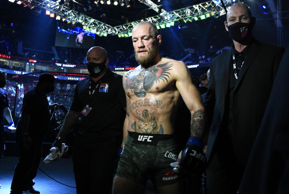 ABU DHABI, UNITED ARAB EMIRATES - JANUARY 23: Conor McGregor of Ireland reacts after his TKO loss to Dustin Poirier in a lightweight fight during the UFC 257 event inside Etihad Arena on UFC Fight Island on January 23, 2021 in Abu Dhabi, United Arab Emirates. (Photo by Chris Unger/Zuffa LLC)
