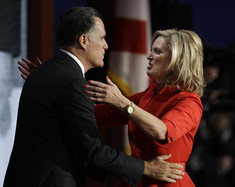 U.S. Republican presidential nominee Mitt Romney hugs his wife Ann after she addressed the Republican National Convention in Tampa, Fla., on Tuesday, Aug. 28, 2012. (AP Photo/Charlie Neibergall)