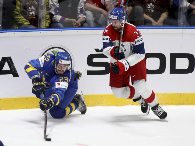 Sweden's Oliver Ekman Larsson, left, checks Czech Republic's Filip Hronek during the Ice Hockey World Championships group B match between Czech Republic and Sweden at the Andrej Nepela Arena in Bratislava, Slovakia, Friday, May 10, 2019. (AP Photo/Ronald Zak)
