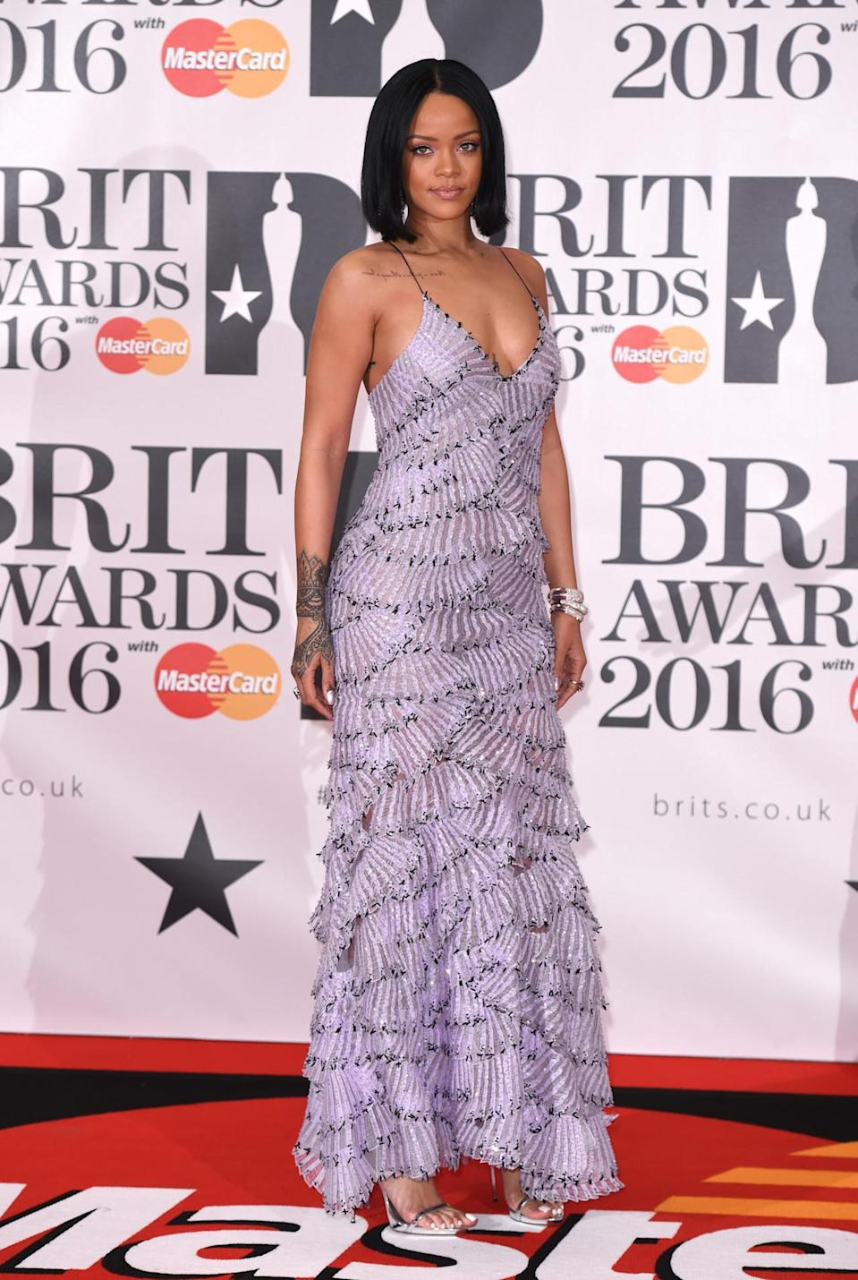 <p>RiRi nailed it in this tiered lilac frock by Armani Privé. The perfect choice for standing out from the crowd without looking too try-hard. <i>[Photo: Rex]</i></p>