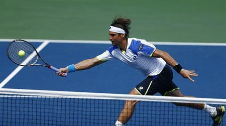 David Ferrer of Spain lunges to make a shot at the net against Mikhail Kukushkin of Kazakhstan at the U.S. Open tennis championships in New York August 31, 2013. REUTERS/Eduardo Munoz