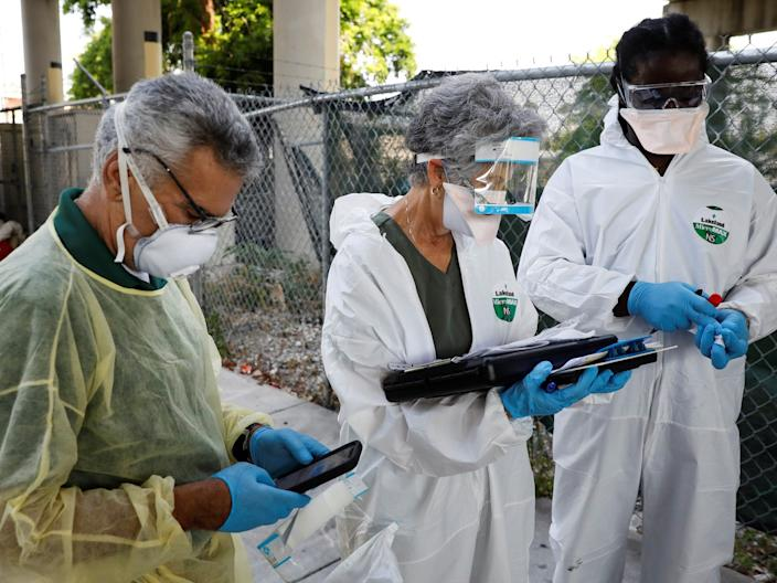 Workers collecting samples from homeless people during a Miami-Dade County testing operation for the coronavirus disease COVID-19 in downtown Miami on April 16.