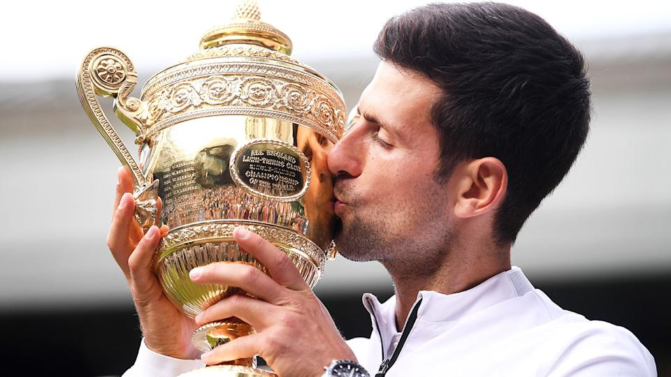 Seen here, Novak Djokovic kisses the Wimbledon trophy.