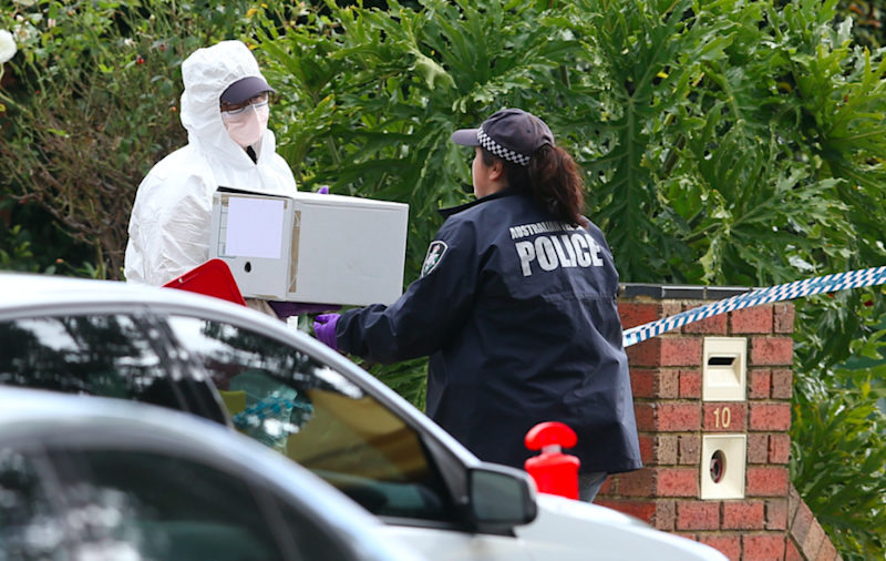 Forensic officers investigate the scene at the apartment block of the Melbourne siege. Photo: AAP