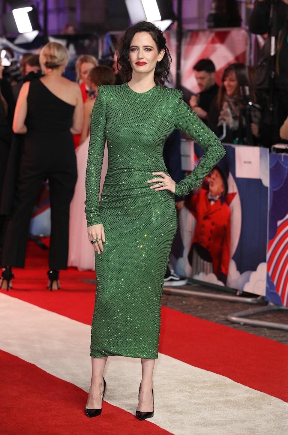 <p>Eva wore a figure-hugging green Alexandre Vauthier dress with Christian Louboutin pointed court shoes. <em>[Photo: Getty]</em> </p>