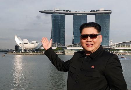 Howard, an Australian-Chinese impersonating North Korean leader Kim Jong Un, poses with the Marina Bay Sands hotel in the background in Singapore