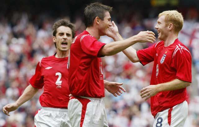 Gary Neville, Frank Lampard and Paul Scholes celebrate a goal