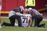 Cleveland Browns offensive tackle Jedrick Wills Jr. is helped off the field after getting injured during the first half of an NFL divisional round football game against the Kansas City Chiefs, Sunday, Jan. 17, 2021, in Kansas City. (AP Photo/Charlie Riedel)