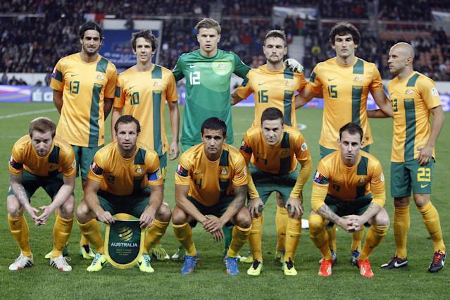 FILE - In this Oct. 11, 2013 file photo, Australia soccer team poses prior to the start their international soccer friendly match between France and Australia at the Parc Des Princes stadium in Paris, France. Background from left: Rhys Williams, Robbie Kruse, Mitchell Langerak, James Holland, Mile Jedinak and Mark Bresciano. Foreground from left: David Carney, Lucas Neill, Tim Cahill, Matty McKay and Luke Wilkshire. The draw for the 2014 World Cup finals takes place Friday Dec. 6, 2013 near Salvador, Brazil. The 32 teams will be drawn into eight groups of four. The top two in each group will progress to the knockout stages. Twelve stadiums in twelve cities will host matches. (AP Photo/Francois Mori, File)
