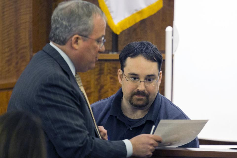 Prosecutor Patrick Bomberg (L) reviews an exhibit with Needletech employee Michael Ribiero, who heard popping sounds on the night in question, during the murder trial of former NFL player Aaron Hernandez at the Bristol County Superior Court in Fall River, Massachusetts, February 23, 2015. Hernandez is charged with the 2013 murder of Odin Lloyd, 27, a semiprofessional football player who had been dating the sister of Hernandez's fiancee. REUTERS/Dominick Reuter/Pool (UNITED STATES)
