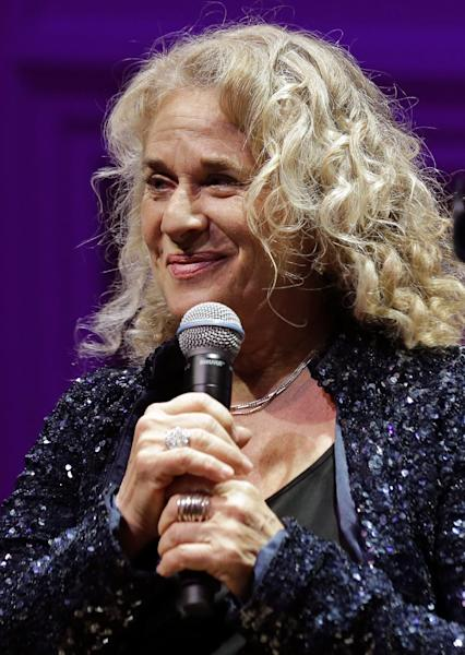 Singer-songwriter Carole King, pauses while speaking during an event to honor her with the Gershwin Prize for Popular Song, at the Library of Congress, Tuesday, May 21, 2013 in Washington. (AP Photo/Alex Brandon)