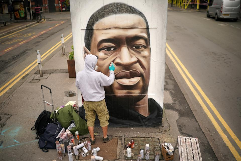 MANCHESTER, UNITED KINGDOM - JUNE 03: Graffiti artist Akse spray paints a mural of George Floyd in Manchester's northern quarter on June 03, 2020 in Manchester, United Kingdom. The death of an African-American man, George Floyd, while in the custody of Minneapolis police has sparked protests across the United States, as well as demonstrations of solidarity in many countries around the world. (Photo by Christopher Furlong/Getty Images)