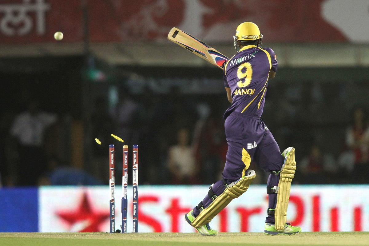 Manoj Tiwary of Kolkata Knight Riders is bowled by Parvinder Awana of Kings XI Punjab during match 20 of the Pepsi Indian Premier League between The Kings XI Punjab and the Kolkata Knight Riders held at the PCA Stadium, Mohal, India  on the 16th April 2013..Photo by Shaun Roy-IPL-SPORTZPICS  ..Use of this image is subject to the terms and conditions as outlined by the BCCI. These terms can be found by following this link:..https://ec.yimg.com/ec?url=http%3a%2f%2fwww.sportzpics.co.za%2fimage%2fI0000SoRagM2cIEc&t=1503012825&sig=Z1sobIl1ECcxxyxlfNdKxQ--~D
