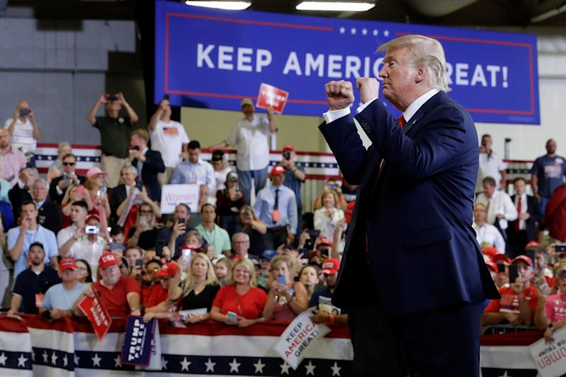 President Donald Trump greets the crowd at a political rally Monday in Fayetteville, N.C.