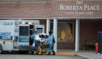 Paramedics transport a resident of Roberta Place long-term care home, in Barrie, Ont., on Jan. 18, 2021. The Canadian Red Cross was deployed to help manage a major outbreak at the home — one of the hardest hit by COVID-19 in Ontario.