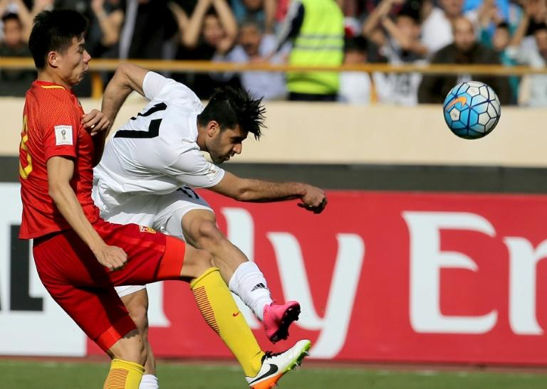 Iran's Mehdi Taremi (right) in action against China during a 2018 World Cup qualifier in Tehran on March 28, 2017