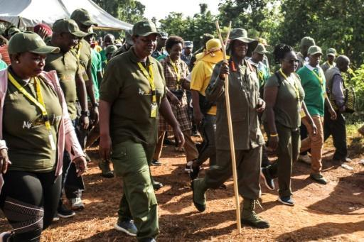 Ugandan President Yoweri Museveni and veterans and Members of Parliament, march through the jungle as he retraces the route which his guerrilla forces took 35 years ago