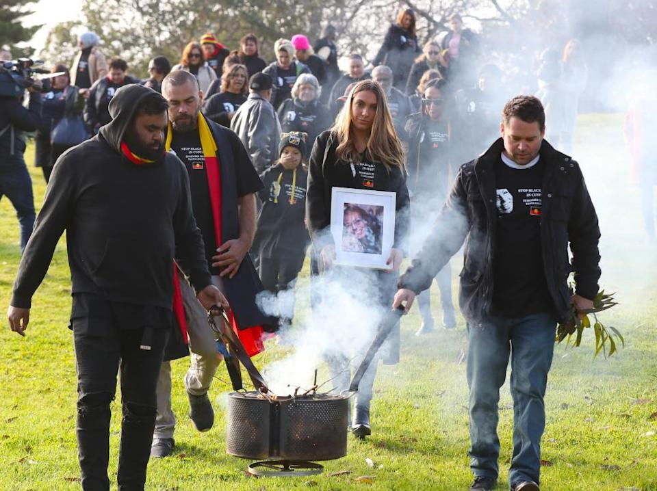 Tanya Day's family members, including Apryl Day (centre), march to the coroner's court in August 2019 after a smoking ceremony.