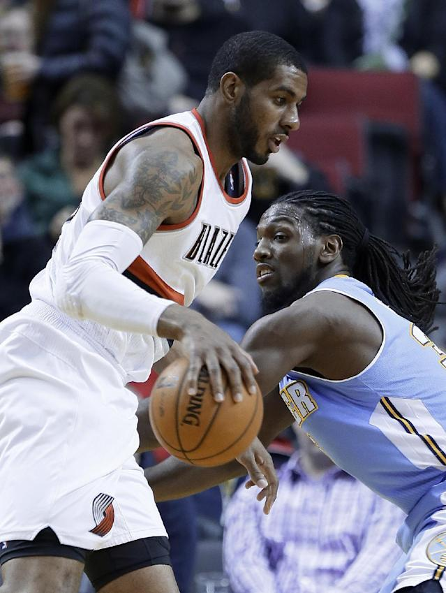 Portland Trail Blazers forward LaMarcus Aldridge, left, drives on Denver Nuggets forward Kenneth Faried during the first half of an NBA basketball game in Portland, Ore., Thursday, Jan. 23, 2014. (AP Photo/Don Ryan)