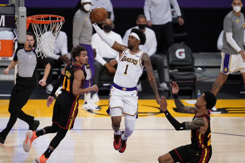 Los Angeles Lakers guard Kentavious Caldwell-Pope (1) drives to the basket against the Atlanta Hawks during the first half of an NBA basketball game Saturday, March 20, 2021, in Los Angeles. (AP Photo/Marcio Jose Sanchez)
