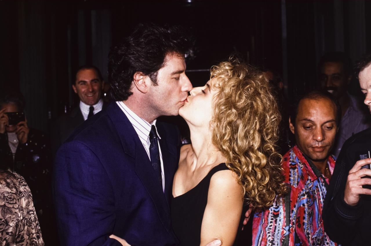 "Once Preston was single again, Travolta swooped in to sweep her off her feet.   On New Year's Eve 1991, Travolta got down on one knee inside the Palace Hotel restaurant in Gstaad, Switzerland, and <a href=""https://people.com/archive/kelly-preston-went-for-a-spin-on-the-rink-and-ended-up-with-a-big-chunk-of-ice-from-john-travolta-vol-35-no-2/"">proposed</a> with a six-carat yellow-and-white diamond ring.  <em>Look Who's Talking Too</em> producer Jonathan Krane said even Preston was surprised by the sudden proposal. When Travolta popped the question, Krane said, ""she screamed.""  Preston eagerly told <em>Entertainment Tonight</em> shortly after that the two ""plan to have some babies.""  ""We're practicing right now,"" she said during her 1991 <a href=""https://people.com/archive/cover-story-theyll-take-romance-vol-35-no-7/"">interview</a> with the outlet. ""This could be barefoot and pregnant for the next 10 years."""