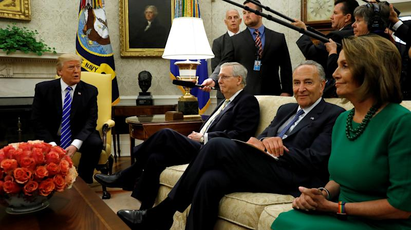 President Donald Trump meets with, from left to right, Sen. Mitch McConnell (R-Ky.), Sen. Chuck Schumer (D-N.Y.) and Rep. Nancy Pelosi (D-Calif.) on Wednesday, Sep. 6, 2017. (Kevin Lamarque / Reuters)