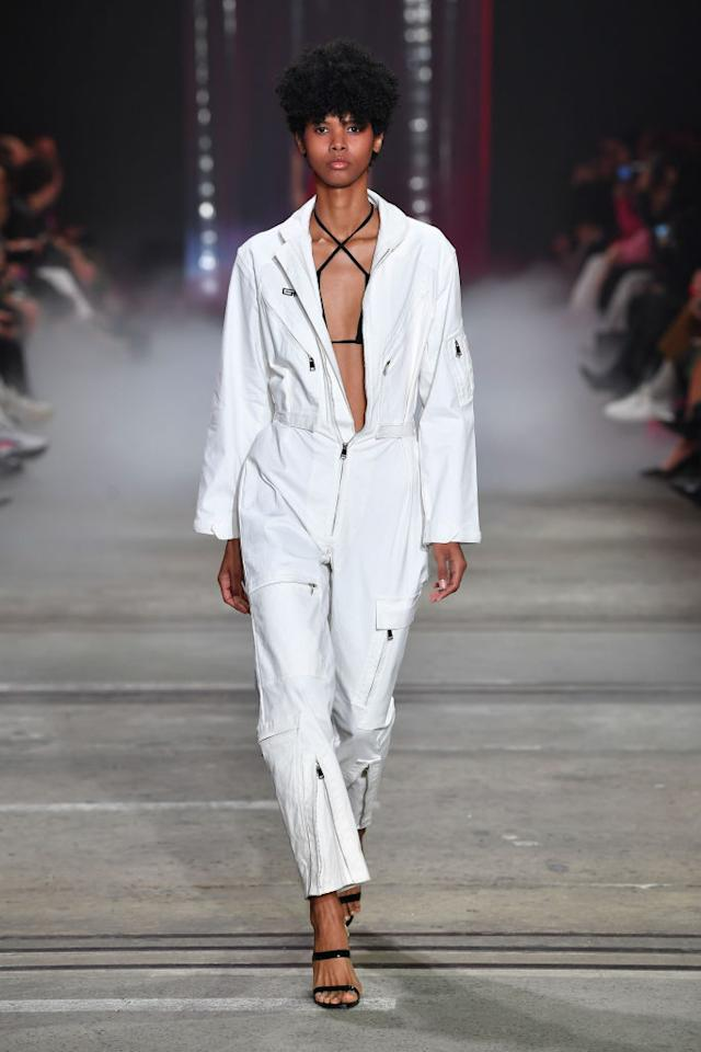 <p>A model walks the runway wearing a white jumpsuit during the I.AM.GIA show at Mercedes-Benz Fashion Week Australia Resort 19 Collections at Carriageworks on May 16, 2018, in Sydney, Australia. (Photo: Getty Images) </p>
