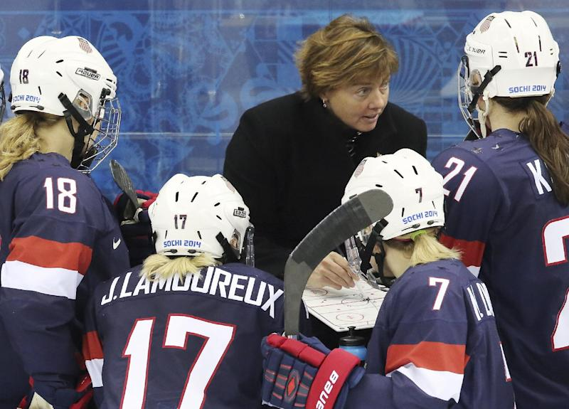 USA head coach Katey Stone talks with the team during a break in the third period of the game against Switzerland during the 2014 Winter Olympics women's ice hockey match at Shayba Arena, Monday, Feb. 10, 2014, in Sochi, Russia. (AP Photo/J. David Ake)