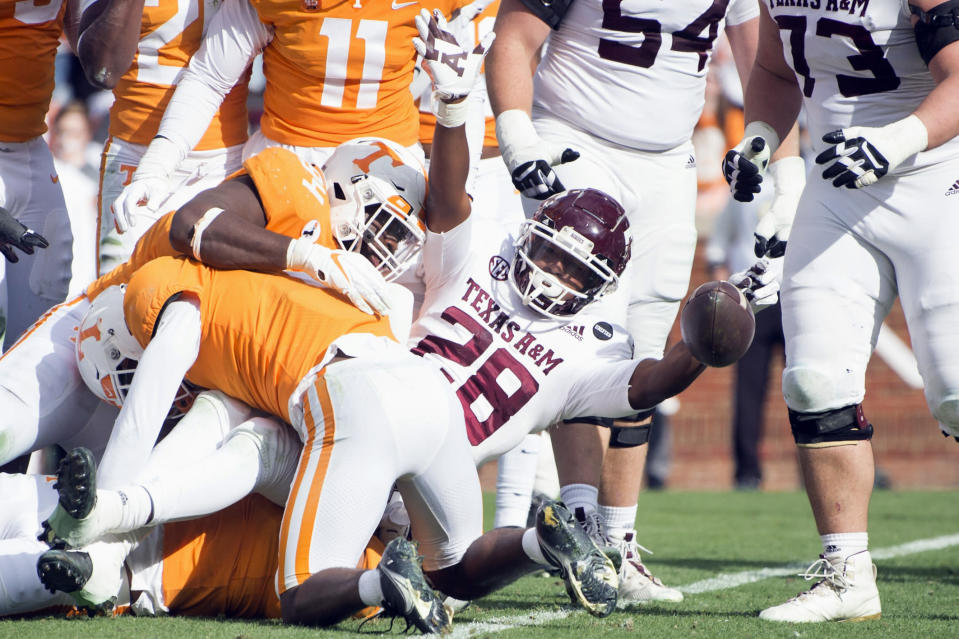 Texas A&M running back Isaiah Spiller (28) celebrates a touchdown against Tennessee during an NCAA college football game in Neyland Stadium in Knoxville, Tenn., Saturday, Dec. 19, 2020. (Brianna Paciorka/Knoxville News Sentinel via AP, Pool)