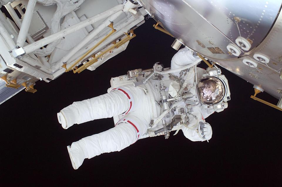 """Expedition 20 flight engineer Nicole Stott participates in the STS-128 mission's first spacewalk as construction and maintenance continue on the International Space Station in 2009.<span class=""""copyright"""">Courtesy NASA</span>"""