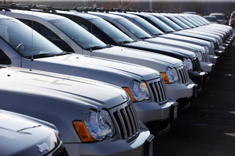 FILE - In this March 7, 2010 file photo, 2010 Jeep Grand Cherokees sit at a Chrysler Jeep dealership in Centennial, Colo. Chrysler is recalling 469,000 Jeep SUVs worldwide because they can shift into neutral without warning, the company announced Saturday, May 11, 2013. The recall affects 2005 to 2010 Grand Cherokees and 2006 to 2010 Commanders. (AP Photo/David Zalubowski, File)