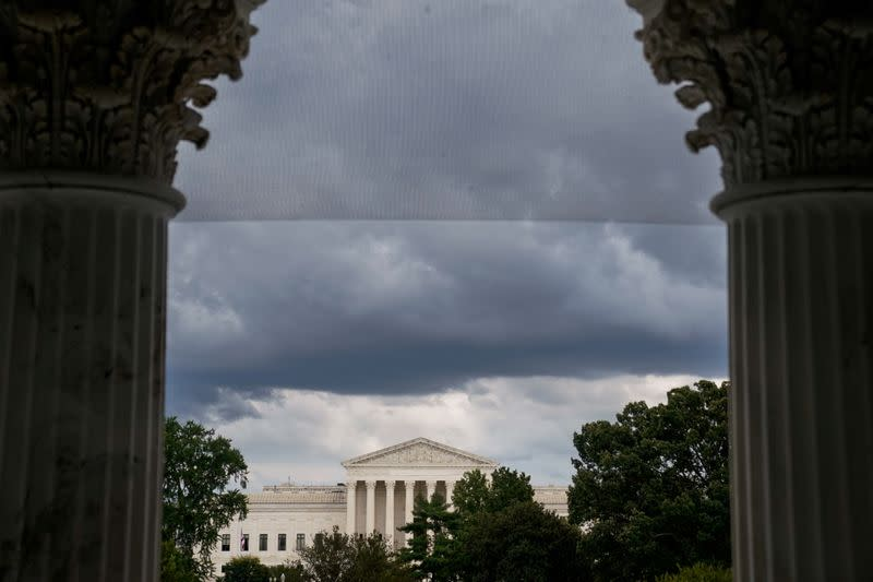 FILE PHOTO: The U.S. Supreme Court is seen through the U.S. Capitol columns in Washington