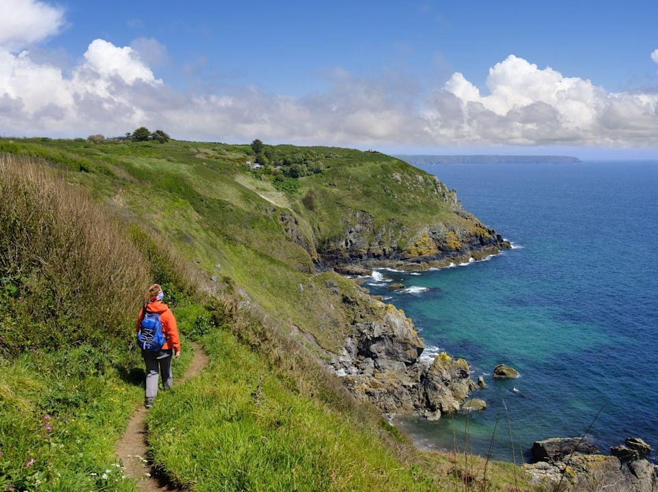 """<p>With its outstanding coastline, excellent paths and fabulous culture, Cornwall is the perfect place for a late-summer getaway when the crowds have gone home. On Country Living's premium walking tour, which includes a stay at an adults-only country retreat and a musical evening with sea shanty singers The Oggymen, you'll experience the best of the county this September. Cream tea, guided walks and visits to gardens are also included in the trip that's ideal for solo travellers.</p><p><a class=""""link rapid-noclick-resp"""" href=""""https://www.countrylivingholidays.com/tours/cornwall-walking-tour"""" rel=""""nofollow noopener"""" target=""""_blank"""" data-ylk=""""slk:FIND OUT MORE"""">FIND OUT MORE</a></p>"""