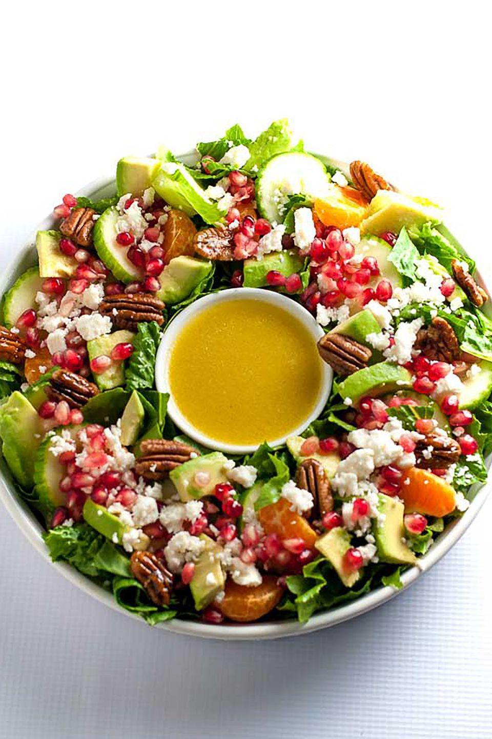 """<p>This salad uses seasonal fruits like pomegranate and mandarins for a light, citrusy lunch. Arrange it to look like a wreath for an extra fun holiday touch.</p><p><strong>Get the recipe at <a href=""""https://www.flavourandsavour.com/pomegranate-mandarin-salad-avocado-feta/"""" rel=""""nofollow noopener"""" target=""""_blank"""" data-ylk=""""slk:Flavour & Savour"""" class=""""link rapid-noclick-resp"""">Flavour & Savour</a>.</strong><br></p>"""
