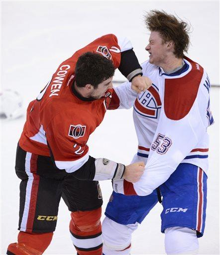 Ottawa Senators' Jared Cowen and Montreal Canadiens' Ryan White fight during third period of game three of first round NHL Stanley Cup playoff hockey at the Scotiabank Place in Ottawa on Sunday, May 5, 2013. (AP Photo/The Canadian Press, Fred Chartrand)